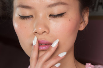Pristine white polish is an excellent choice for winter nails.