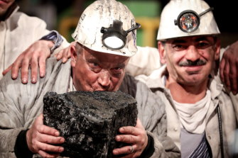 Germany is one place turning its back on coal: Miners kiss the last piece of coal during a farewell event for the German hard coal mining industry in 2018.