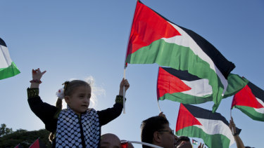 Protesters fly Palestinian flags during a rally in the West Bank Bedouin community of Khan al-Ahmar.