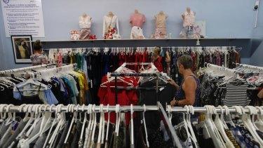 The men bought hundreds of women's blouses.