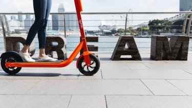 Neuron Mobility's bright orange scooters will soon be seen on Brisbane streets.