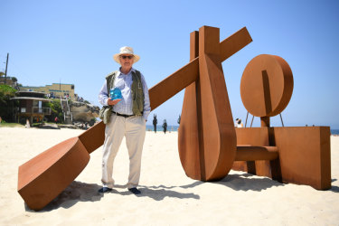 Aqualand Sculpture Award winner Morgan Jones poses for a photo with his sculpture The Sun Also Rises.