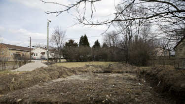 An empty lot in Indianapolis that was sold to an investor. A home was supposed to be built there, but never was.
