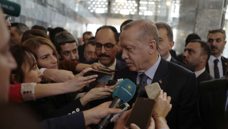 Turkish President Recep Tayyip Erdogan speaks to the media at the parliament in Ankara.