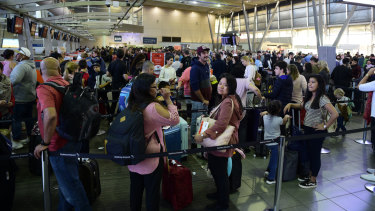 Hundreds of flights in and out of Sydney airport have been delayed or cancelled due to the wild weather and winds currently battering the state.