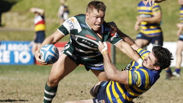 Sydney University's Henry Clunies-Ross makes a tackle in his return to rugby against Warringah.