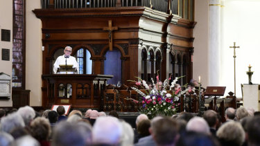 Reverend Peter Kurti speaks during the memorial service for parishioner and Australian climber Ruth McCance.