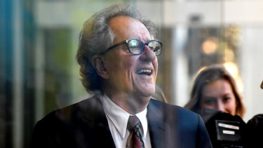 Geoffrey Rush leaves court on Monday afternoon.