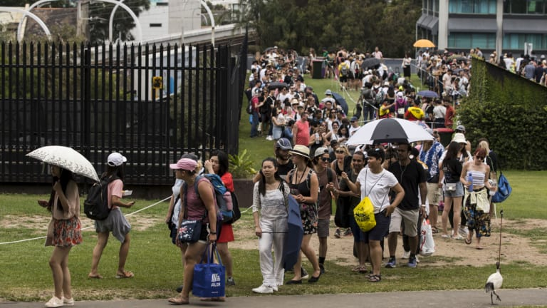 People line up to enter Mrs Macquarie's Chair in preparation for New Year's Eve in Sydney on Monday.