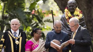 Mayor of Parramatta Andrew Wilson, First Lady Sovita Kovind, Indian President Ram Nath Kovind and Prime Minister Scott Morrison at the unveiling of a statue of Mahatma Gandhi at Jubilee Park in Parramatta.