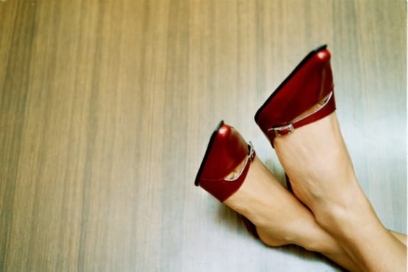 red . 011122 AFR pic by Tanya Lake generic red stilletto stillettos putting feet up on desk women mother female executive corporate holidays relaxation overtime over time over worked work relax woman