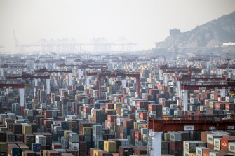 """Shipping containers next to gantry cranes at the Yangshan Deepwater Port in Shanghai, China, on Monday, Jan, 11, 2021. U.S. PresidentDonald Trumpfamouslytweetedthat """"trade wars are good, and easy to win"""" in 2018 as he began to impose tariffs on about$360 billion of importsfrom China. Turns out he was wrong on both counts."""