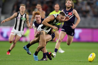 Brayden Sier, pictured being tackled in round nine against the Dockers, was injured in the clash against the Crows.