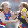 iarna Ernst of the Bulldogs and Tilly Lucas-Rodd of the Blues contest the ball during the Round 7 match between the Western Bulldogs and the Carlton Blues at Victoria University Whitten Oval in Melbourne, Sunday, March 17, 2019. (AAP Image/Daniel Pockett) NO ARCHIVING, EDITORIAL USE ONLY