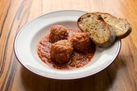 Go to this Brunswick bar for nonna's meatballs, stay for the martinis