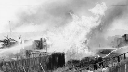 From the Archives: Collingwood timber fire spreads to train station