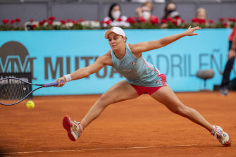 Australia's Ashleigh Barty returns the ball to Aryna Sabalenka of Belarus during their women's final match at the Mutua Madrid Open tennis tournament in Madrid, Spain, Saturday, May 8, 2021. (AP Photo/Bernat Armangue)