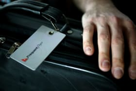 Two passengers who had economy tickets claimed they were refused access to a first class coat locker despite holding status with the Qantas frequent-flyer program.