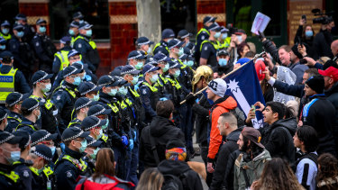 Police and protesters come face to face on Saturday.