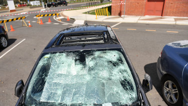 Cars sitting outside Old Parliament House in Canberra were pummelled by hail.