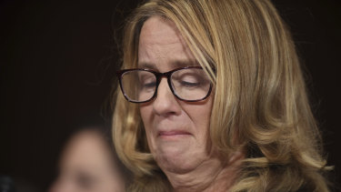 Christine Blasey Ford holds back tears as she testifies to the US Senate on September 27 about an alleged assault by Supreme Court Justice Brett Kavanaugh.