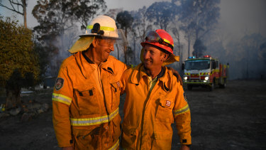 RFS father and son volunteers Bob (left) and Greg Kneipp fighting fires at Torrington, near Glen Innes.