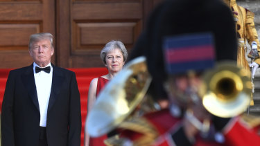 Theresa May stands with US President Donald Trump, left, arrive for a black-tie dinner at Blenheim Palace, west of London, in July.  Trump's first visit to the UK.