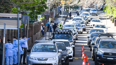 Residents lined up for COVID-19 tests in the Rozelle area of Sydney on Friday.