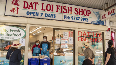 Ly Tran and her son Ray Tran at Dat Loi Fish Shop in Campsie