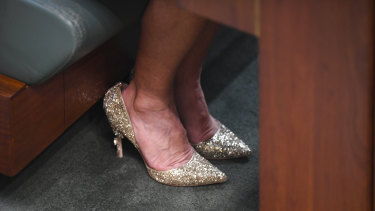 Former Australian Foreign Minister Julie Bishop's shoes are seen on the floor of the House of Representatives during a motion to suspend standing orders calling for government intervention for the dairy industry at Parliament House in Canberra, Thursday, February 21.
