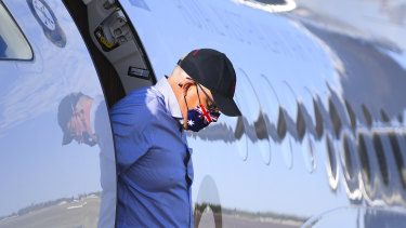 Australian Prime Minister Scott Morrison wears a face mask as he disembarks a plane after landing at Longreach Airport on Tuesday.