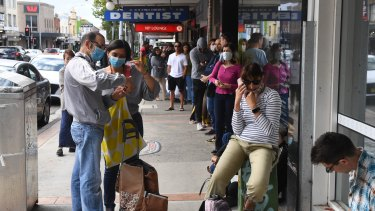 People queue at Centrelink in Marrickville, Sydney.