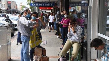 People queue at Centrelink in Sydney.