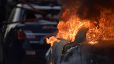 An Atlanta Police Department vehicle burns during a demonstration against police violence in Atlanta on Friday.