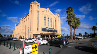 People queue for testing at the Palais Theatre in St Kilda, in Melbourne's inner south.