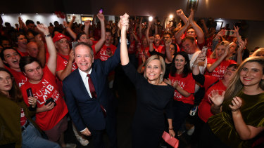 Labor leader Bill Shorten and returned MP Susan Lamb celebrate as they arrive at their election night function in Caboolture, north of Brisbane, on Saturday.