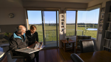 Retired couple Robert Newall and wife Karen in front of the farmland at Ventnor, Phillip Island, which had been rezoned by the former Planning Minister Matthew Guy.