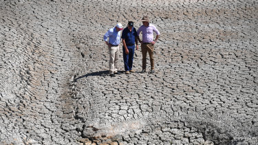 Water Resources Minister David Littleproud examines a dried-up river bed, with Treasurer Josh Frydenberg and farmer Dino Rizzato, near Stanhope in Queensland, last month.