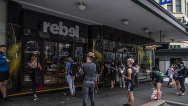 People queues outside Rebel Sport as they wait to buy gym equipment as Sydney closes down.