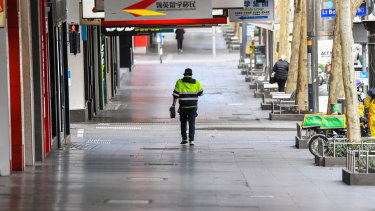 A deserted Swanston Street in Melbourne's central business district. Victoria's lockdown is hitting employment and business activity with forecasts up to 100,000 jobs nationally disappeared during August.