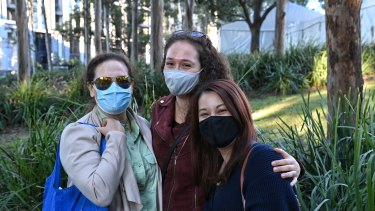 Gail Rodney, Dayna Kohn and Tomoko Masters arrive for the opening of the Olympic Park vaccination hub on Monday at 8am.