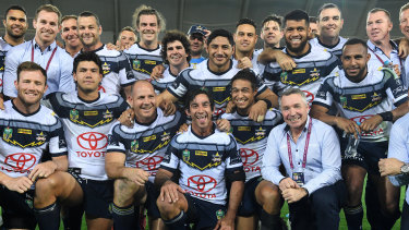 Unforgettable: Johnathan Thurston poses in a memorial photo with Cowboys teammates and coach Paul Green after the final whistle.