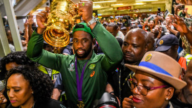 Siya Kolisi holds the World Cup trophy aloft in Johannesburg.