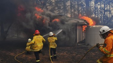"A local fire crew were ""burnt over"" as they tried to save a home in Bundanoon on Thursday."