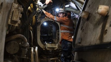 A worker operates the tunnel boring machine known as Kathleen, on the Sydney Metro tunnel.