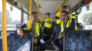 Transport Minister Andrew Constance and Treasurer Dominic Perrottet on board a bus.