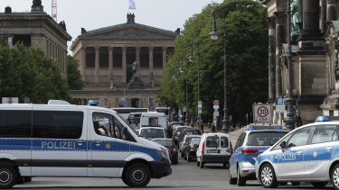 Police vehicles stand in front of Berlin Cathedral after the attack.