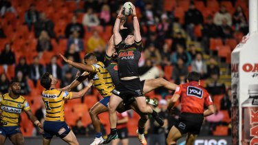 Liam Martin flies high to pull in a Nathan Cleary kick on Friday night.
