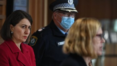 NSW Premier Gladys Berejiklian and Deputy Commissioner Gary Worboys listen as Chief Health Officer Dr Kerry Chant delivers the COVID numbers.