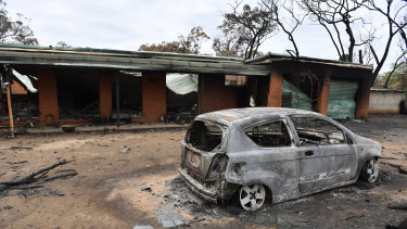 A house and car damaged by a bushfire that swept through Balmoral in the NSW Southern Highlands on Saturday.